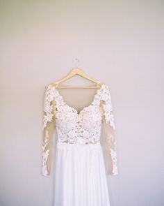A Unique Lacy Long Sleeved Wedding Dress with a Satin Skirt. Event by Spencer Special Events, S.C.