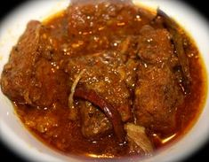 The Fiery Pork Vindaloo Recipe - - A fiery recipe straight from the heart of Goa is here to win over your tastebuds. Be prepared to be seduced by this feisty Indo-Portuguese pork preparation forever. Goan Recipes, Spicy Recipes, Curry Recipes, Indian Food Recipes, Cooking Recipes, Diwali Recipes, Filipino Recipes, Roasted Pork Belly Recipe, Pork Belly Recipes