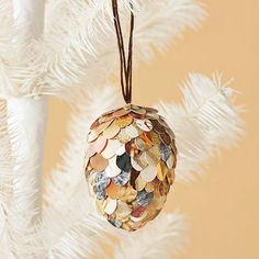 How pretty! We love this paper pinecone Christmas ornament. See more ornament ideas: http://www.bhg.com/christmas/ornaments/pretty-christmas-ornaments-made-from-paper/#page=1