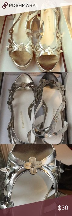 Etienne Aigner summer spring size 8 shoe Silver color straps flower motive in front shoes great for spring summer with wedge heel up your wardrobe with these cuties I love them only they are big for me never worn comes with box bought in 2013 sitting in my closet forever lost a shoe size 🤩 size 8 Etienne Aigner Shoes Sandals