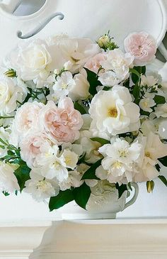 Pretty white and pink floral arrangement.