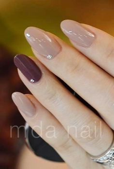 ..nude nails with a wine accent nail and rhinestones..