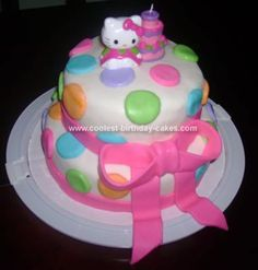 Homemade Hello Kitty Birthday Cake: I made this Hello Kitty Birthday Cake for my daughter's third birthday.  It is a two tier Fun-fetti cake mix with a layer of buttercream frosting.  I covered