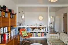 Thayer's Modern Beachy Apartment. I love the books is the divider between the living room and dining room