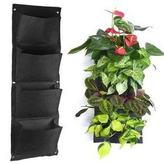 Enjoy beautiful flowers, fragrant herbs, or fresh vegetables with this hanging wall planter. The versatile design accommodates indoor and outdoor environments. Four pockets provide space for multiple Verticle Garden, Hanging Wall Planters, Hanging Gardens, Diy Hanging, Grow Bags, Plantar, Outdoor Plants, Indoor Outdoor, Outdoor Life