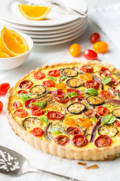 Farmers' Market Quiche - A tasty, fresh vegetable quiche filled with zucchini, onions, tomatoes and cheese. Fresh picked herbs and a flaky crust make this a wonderful addition to your brunch table! www.savingdessert.com