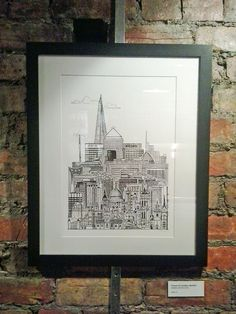Framed Towers of London print on display at Harris + Hoole coffee shop, Crouch End Broadway, London N8 in March 2013.