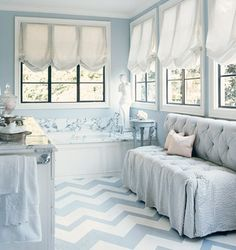 Gorgeous blue and white bathroom retreat by Mary McDonald. Love the chevron painted floors, girly relaxed roman shades, and tufted big seersucker settee with draped edges. Interior, Home, Painted Wood Floors, Balloon Shades, Decor Inspiration, Painted Hardwood Floors, Blue Bathroom, Flooring, Flooring Inspiration