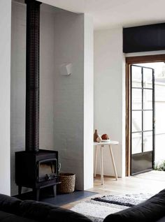 I love the simple wood burning stove and the little nook that is sits in.