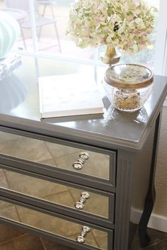 Rustoleum spray paint in dark grey mirrors professionally cut & holes drilled, paint is high gloss with clear gloss enamel over the top.   (the before pic would shock you that this beauty can come from that!)