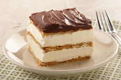 """Eclair Cake.  Instant pudding mix, milk, Cool Whip, and graham crackers, covered in chocolate icing.  That's it!  (Also do a search for """"eclair cake"""" or """"cream puff cake"""" to see other options.)"""