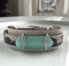 Stone leather cuff hugs the white snakeskin leather keeper with the healing green quartz stone. Beautiful blend of class and badass. Show this look at https://www.keep-collective.com/with/karencan