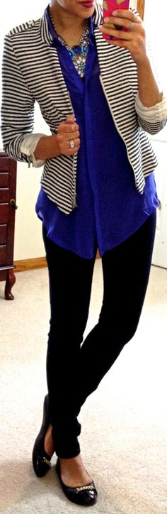 Black skinny, blue collared blouse, black and white stripe jacket, black flats and belonged out blue necklace.