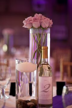 Love this idea for a table center piece. simple. elegant. inexpensive!  Karen Stott Photography