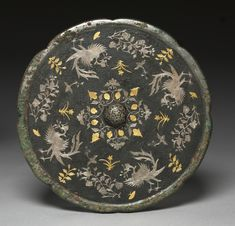 Mirror with Phoenixes, Birds, Butterflies, and Floral Sprays, 700s, China, Tang dynasty (618-907); bronze with silver and gold inlaid lacquer