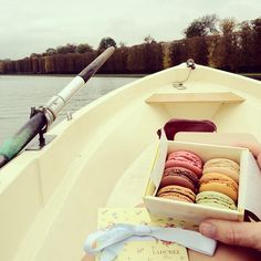 Nicole Warne eating macaroons while rowing down the grand canal at versailles (paris) ..
