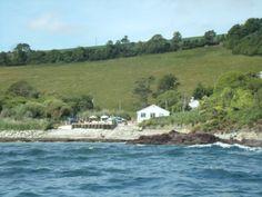 TALLAND BAY-Cornwall Talland Bay beach cafe as seen from the sea.