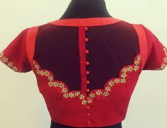 Play with sheer !!! Beautiful red color designer blouse back with floral design hand embroidery kundan work. 15 November 2017