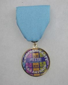 The peaceCENTER's 2015 Fiesta Medal can be had for a $5 donation to the nonprofit organization. But you'll have to run into them at Fiesta events to buy one. Photo: JUANITO M GARZA, By Juanito Garza, San Antonio Express-News / San Antonio Express-News