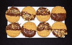 Classic peanut butter cookies dipped in melted chocolate, nuts, and sprinkles #FatFridaysForever