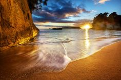 You'll see more than the Southern Cross in New Zealand #travel  Cathedral Cove Beach Sunrise Starburst - New Zealand by Daniel Peckham, via Flickr