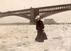 """Mississippi River frozen solid, February 1905 """"The Mississippi River frozen 'solid', February 1905"""". Woman crossing frozen river during Ice Gorge of 1905. Photograph, 1905. Missouri History Museum Photographs and Prints Collections. St. Louis Views. N28412."""