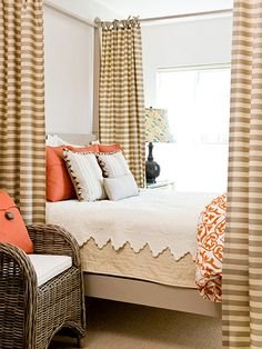 The bedroom welcomes crisp orange as its accent hue with solid throw pillows and a duvet printed with a modern take on a trellis pattern.