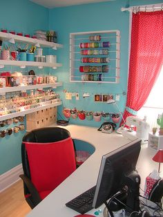 so much that I like...the pop lights under each shelf!  The buckets hanging from a towel rack and the clips on the next one up...all that organized thread!  I need organized thread so badly!