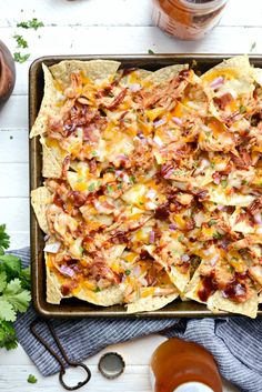 Sheet Pan BBQ Chicken Nachos are unbelievably delicious! Chips topped shredded chicken, cheddar and Monterrey Jack cheese, red onion and bacon! Bbq Chicken Nachos, Barbecue Chicken, Hawaian Chicken, Nacho Fries, Hawaiian Bbq, Favourite Pizza, Cafe Food, Shredded Chicken, Sheet Pan