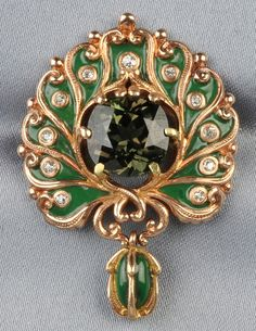 Art Nouveau 18kt Rose Gold and Alexandrite Pendant Brooch, Marcus & Co., centering a cushion-cut alexandrite weighing approximately 7.43 cts., within a peacock-style frame with bezel-set old mine-cut diamonds and green enamel accents, suspending a drop, signed.