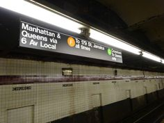 Manhattan & Queens platform sign