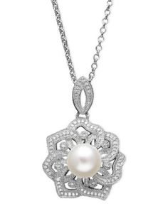 Diamond and pearl pendant. Perfect for a v-neck wedding dress.