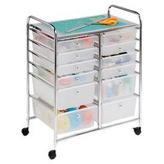 "Keep craft and office supplies on hand with this eye-catching storage cart, showcasing a chrome finish and 12 drawers.    Product: Storage cart Construction Material: Metal and resin Color: Clear and chrome  Features:  Twelve drawers Four wheels provide convenient portability Top shelf Dimensions: 31.75"" H x 25.25"" W x 16.25"" D"