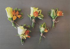 Orange and yellow boutonnieres made by http://lsdesign.co
