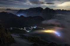 Clouds roll in on the Pordoi Pass as climbers descend the Marmolada , 85 kb