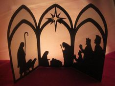 An elegant Nativity display made with metallic cardstock and vellum. Place a tea light or even a small string of Christmas lights behind the