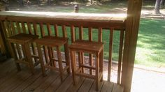 We made a bar on top of the deck railing and bar stools from scrap deck wood.