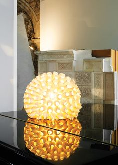 The glowing anemone-like lamp is from Vinçon in Barcelona