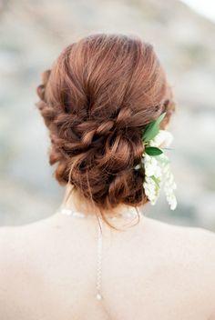 twisted bridal updo   image via: wedding sparrow