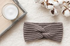Headband with a twist | Knitting pattern | Mirella Moments Knitted Headband Free Pattern, Baby Cardigan Knitting Pattern Free, Baby Hats Knitting, Knitting Kits, Knitting Charts, Knitting Stitches, Knitting Patterns Free, Free Knitting, Knitted Hats