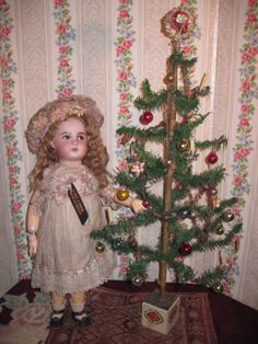 Antique doll with antique feather tree.....