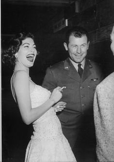 That's General Chuck Yeager laughing it up with Ava Gardner. (He was the first man to break the sound barrier.)