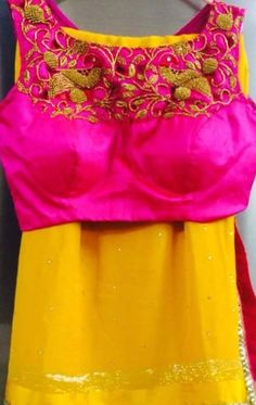 Yellow plain saree with contrast pink embroidered blouse