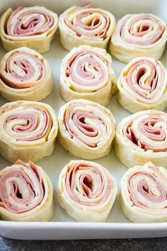 Ham and cheese pinwheels ready for a brown sugar and butter drizzle. Pinwheel Appetizers, Pinwheel Recipes, Finger Food Appetizers, Holiday Appetizers, Pinwheel Sandwiches, Bacon Appetizers, Ham Roll Ups, Ham And Cheese Roll Ups, Ham And Cheese Pinwheels