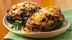 Eggplant goes from an underrated side dish to a spotlight main thanks to the beef and extra veggies that are stuffed inside. The cheese and bread crumbs sprinkled on top will forever change the way you think about eggplant. Eggplant Dishes, Baked Eggplant, Eggplant Parmesan, Progresso Bread Crumbs, Restaurant Dishes, Turkey Sausage, Italian Dishes, Greek Recipes, Vegetable Recipes