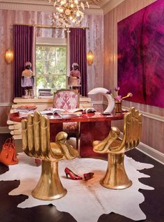 gold hand chairs + bright pink artwork