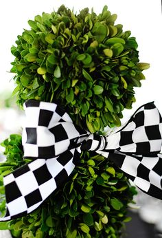 checkered flag ribbon and greenery - Maverick's Race Car Birthday Party by Entertaining with Emily