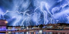 These stunning pictures show hundreds of lightning bolts in full force illuminating the night sky in South Africa.  Alexius van der Westhuizen, a 46-year-old real-estate agent, captured the dramatic thunderstorm over the skies in Johannesburg.  E...