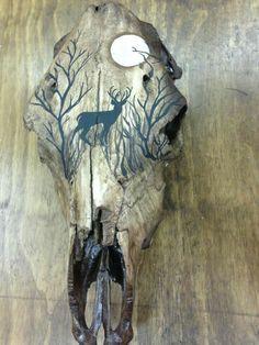 the Plains /PaintingThePlains Painted cow skull, with deer silhouette Deer Skull Art, Cow Skull Decor, Deer Decor, Elephant Skull, Deer Skull Tattoos, Skull Artwork, Antler Crafts, Antler Art, Painted Animal Skulls