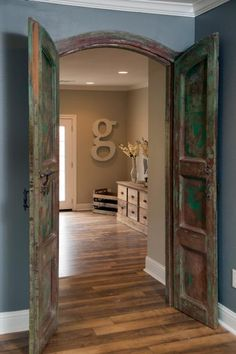 Chip and Joanna take a drab '60s ranch house in the suburbs and turn it into a colorful and comfortable home with a rustic feel and cottage accents.Two sets of antique wooden doors in the study open to the living room.